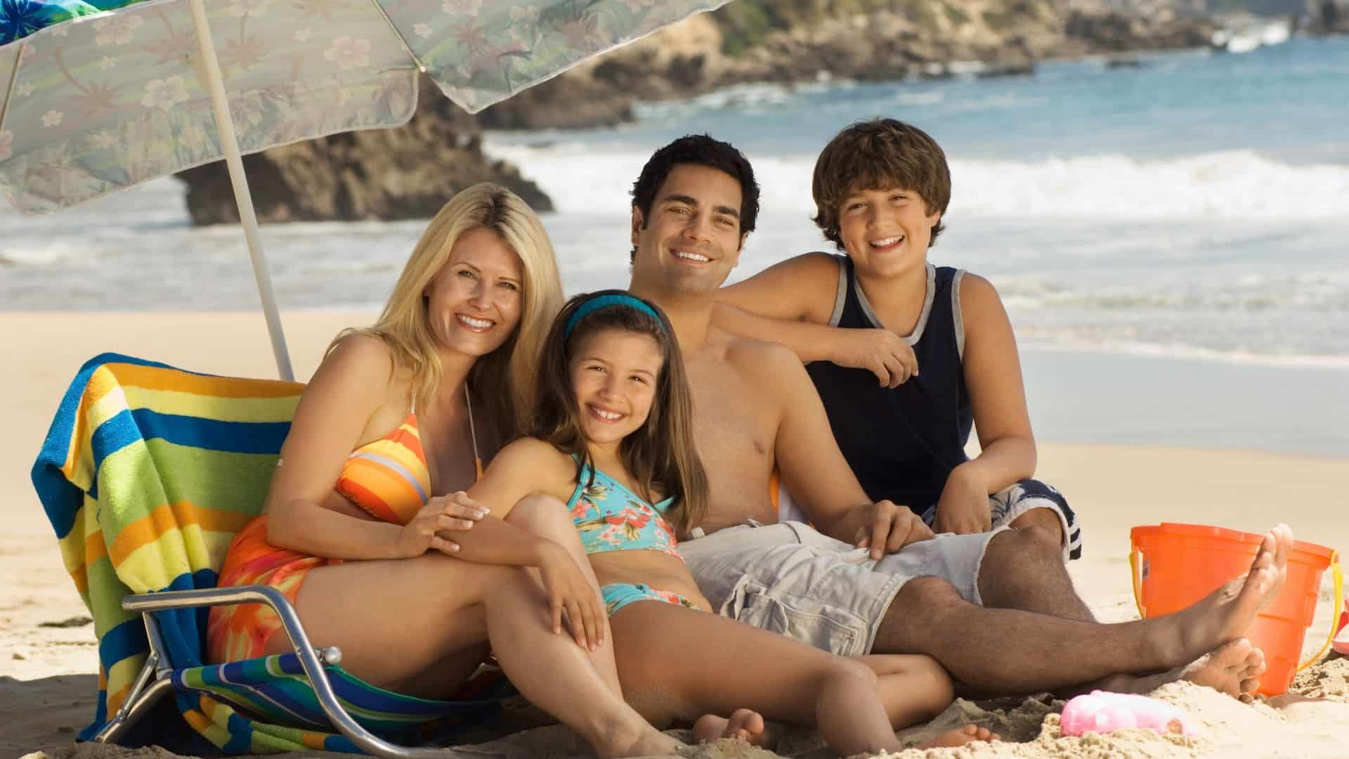 A happy family enjoys the beach