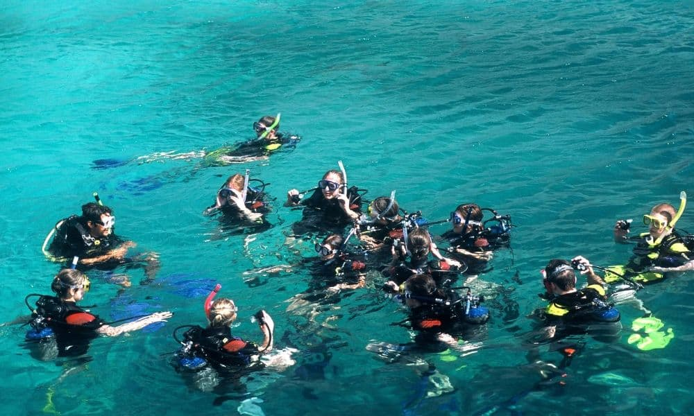a class learning to scuba dive