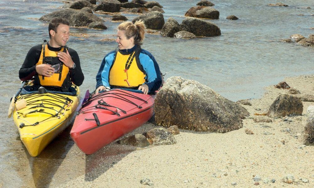 two kayakers in wetsuits