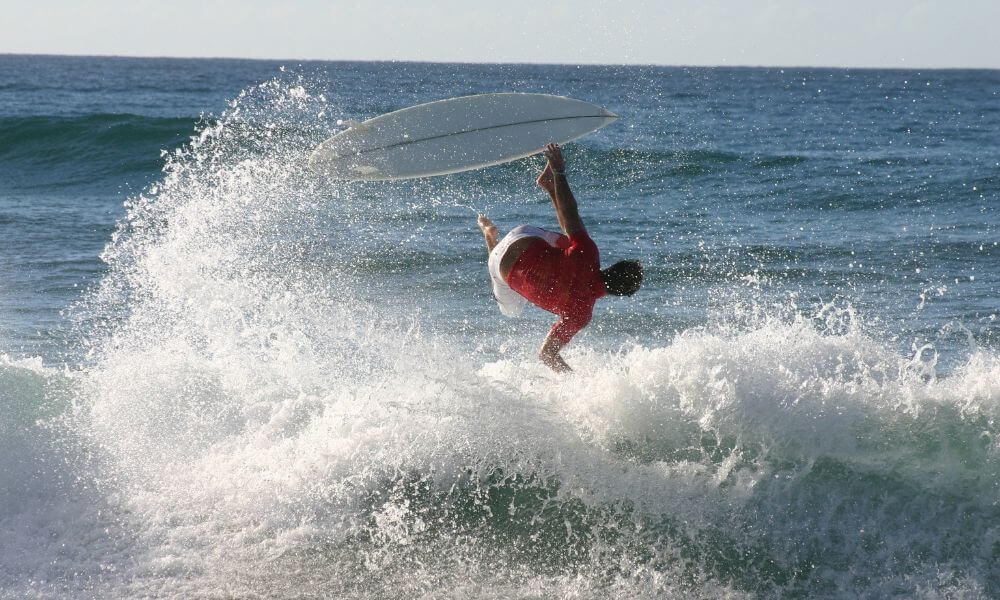 main wiping out on a surfboard
