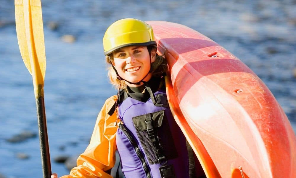woman with kayaking equipment