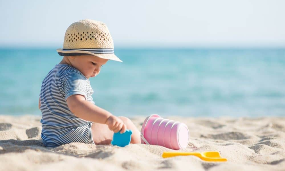 child playing with beach toys