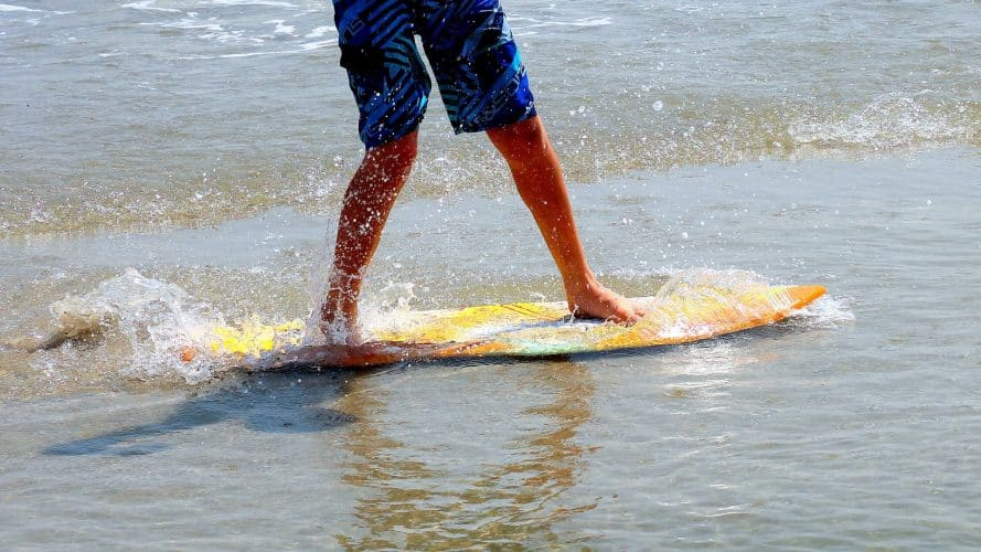 how to ride a skimboard