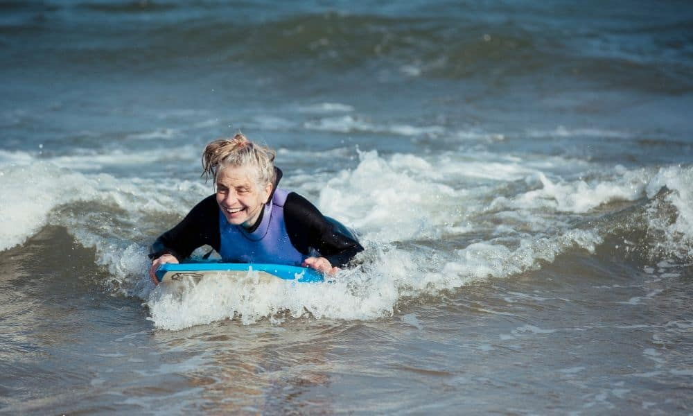 older woman bodyboarding