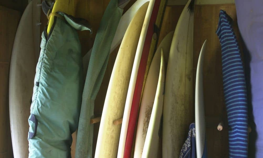 surfboards lined up against th