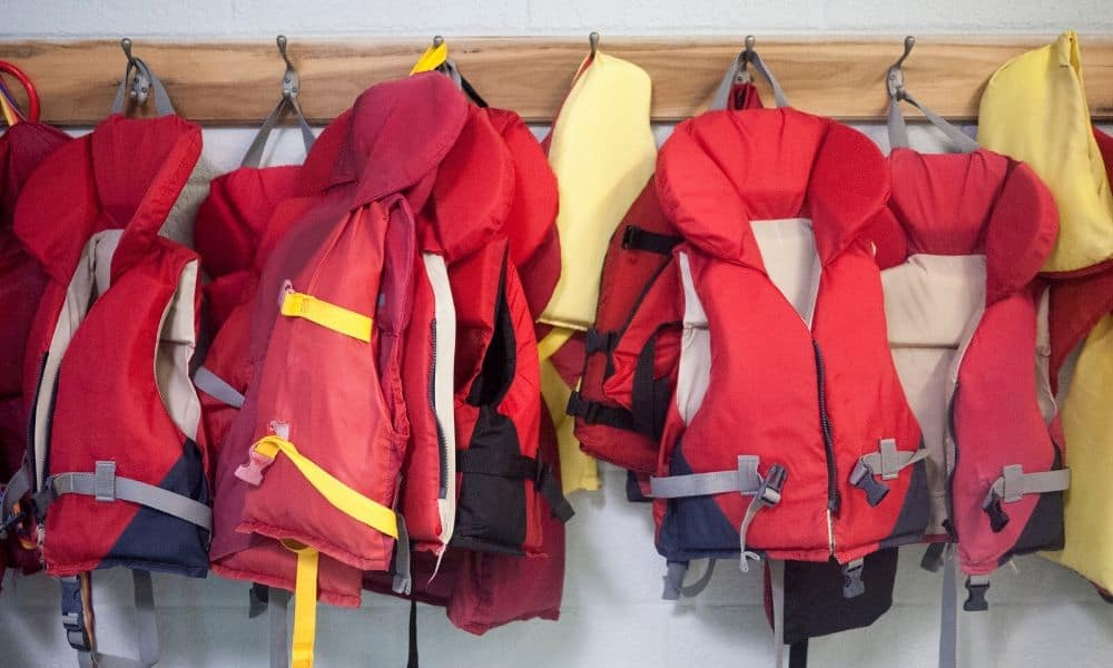 life jackets hanging on the wall