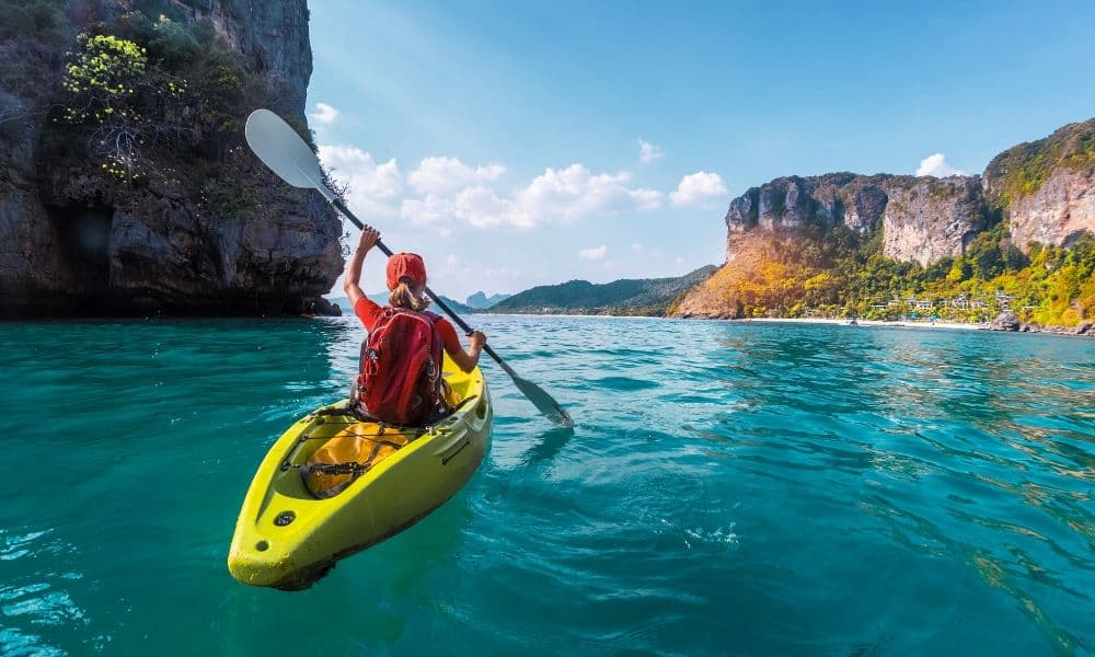 kayaker paddling on calm waters