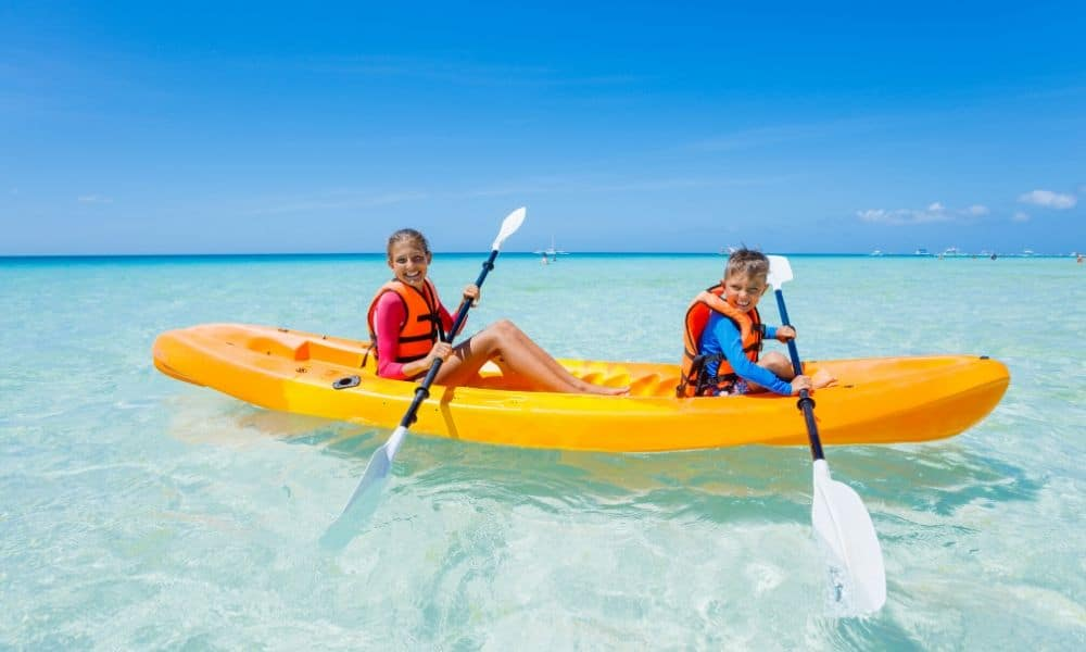 kids in an ocean kayak