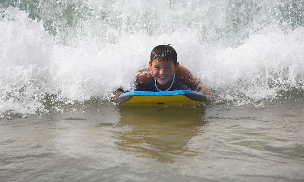 Young boy boogie boarding
