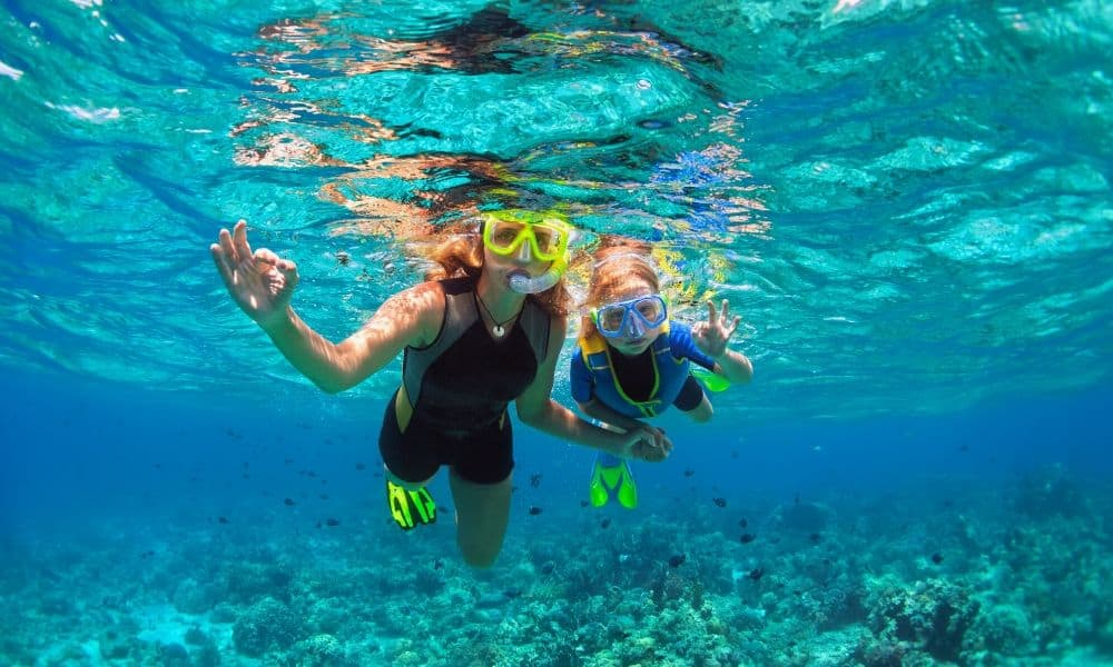 mom and her daughter snorkeling