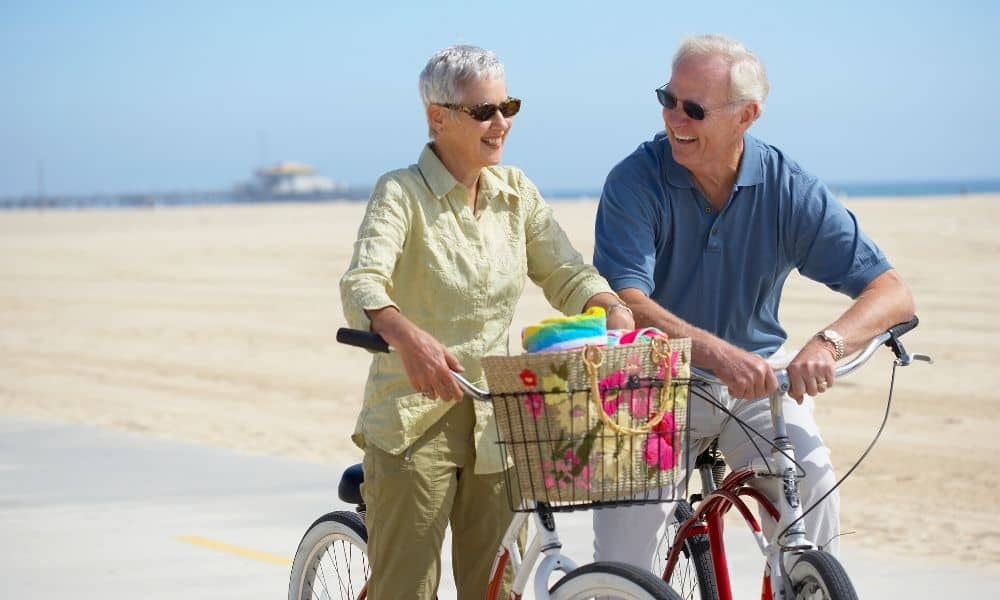 older couple on beach cruisers