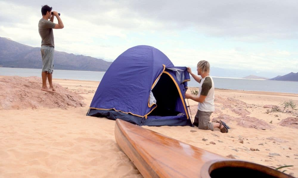 setting up a beach tent