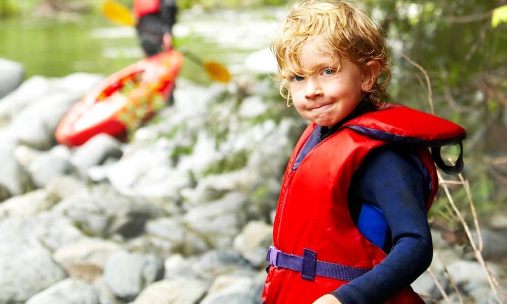young boy wearing a life jacket