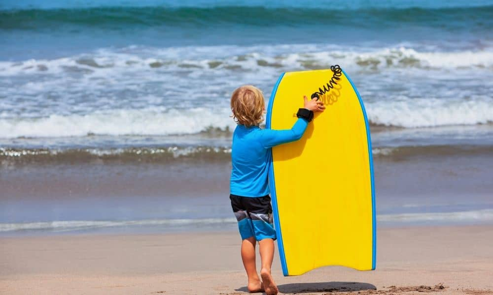 young boy with bodyboard