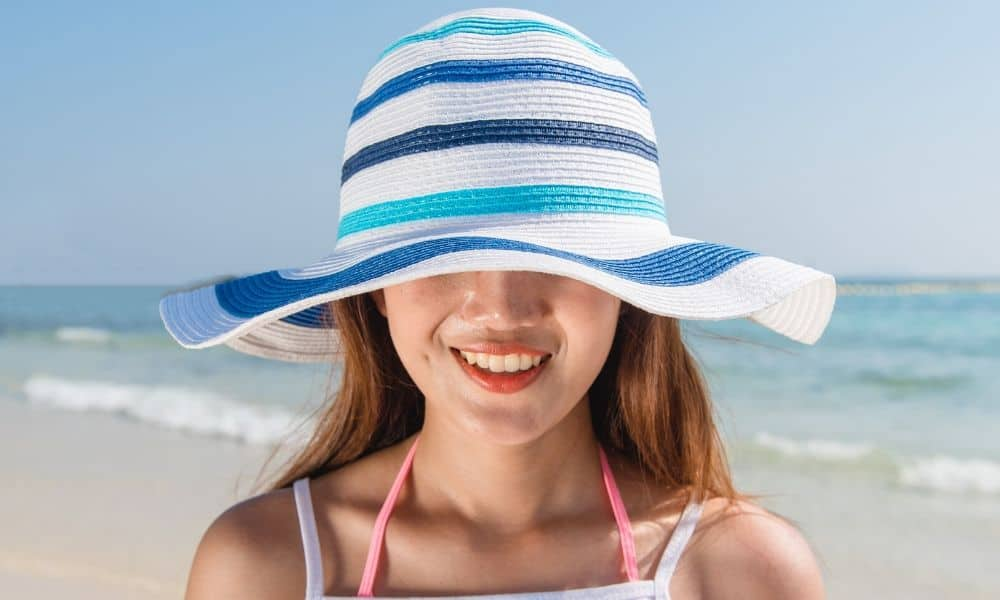woman wearing a beach hat